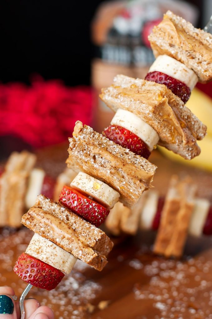 Breakfast kabobs with peanut butter , strawberry and banana