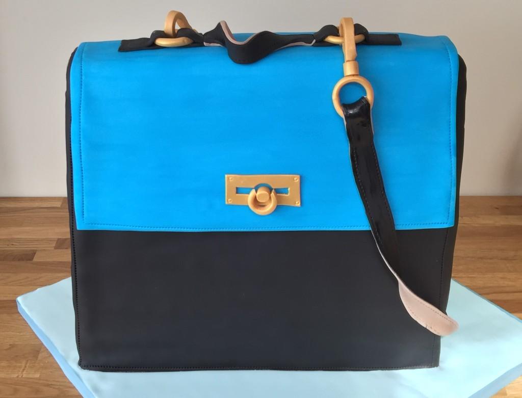 Blue and black handbag cake